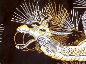 a yukata with gold and white dragon and pine needles on a black background